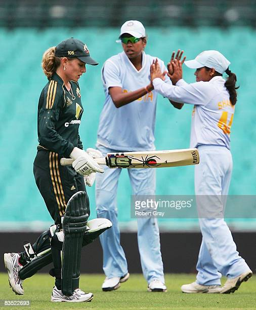 Jodie Fields of Australia walks off the field as Jhulan Goswami and Amita Sharma of India celebrate during the second women`s one day international...