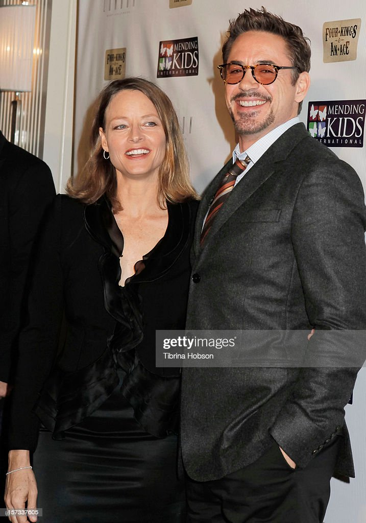 Jodie Foster and Robert Downey Jr. attend the Mending Kids International celebrity poker tournament at The London Hotel on December 1, 2012 in West Hollywood, California.