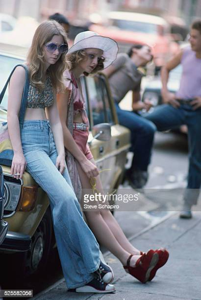 Jodie Foster as the hooker Iris leaning against a parked car on the set of Martin Scorsese's Taxi Driver