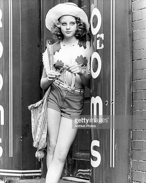 Jodie Foster stands and waits in a scene from the film 'Taxi Driver' 1976