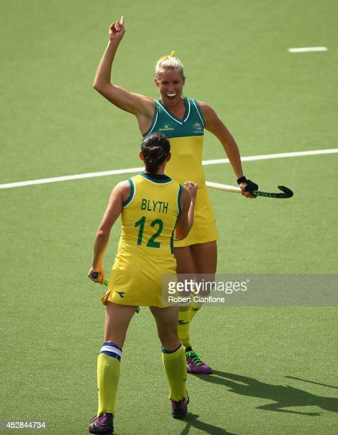 Jodie Kenny of Australia celebrates after she scored a goal during the Women's preliminaries match between Australia and England at Glasgow National...