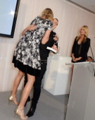 Jodie Kidd accepts the Classic Glamour award from Julien Macdonald as host Laura Whitmore looks on at the 5th annual Rodial Beautiful Awards to...