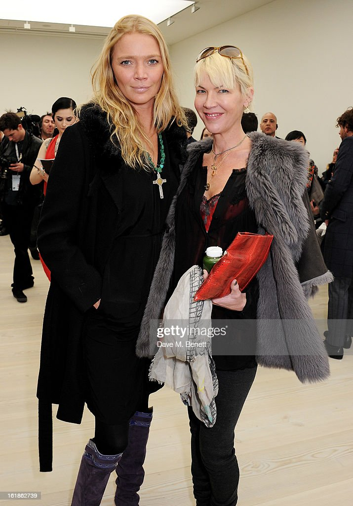 Jodie Kidd (L) and Cynthia Conran attend the Vivienne Westwood Red Label show during London Fashion Week Fall/Winter 2013/14 at the Saatchi Gallery on February 17, 2013 in London, England.