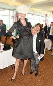 Jodie Kidd and Willie Carson attend Derby Day at the Investec Derby Festival at Epsom Downs Racecourse on June 6 2014 in Epsom England