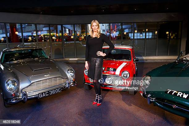 Jodie Kidd host of the Classic Car Show first airing February 5 at 7pm on Channel 5 poses with an Aston Martin DB5 Mini Cooper and Jaguar Etype at...