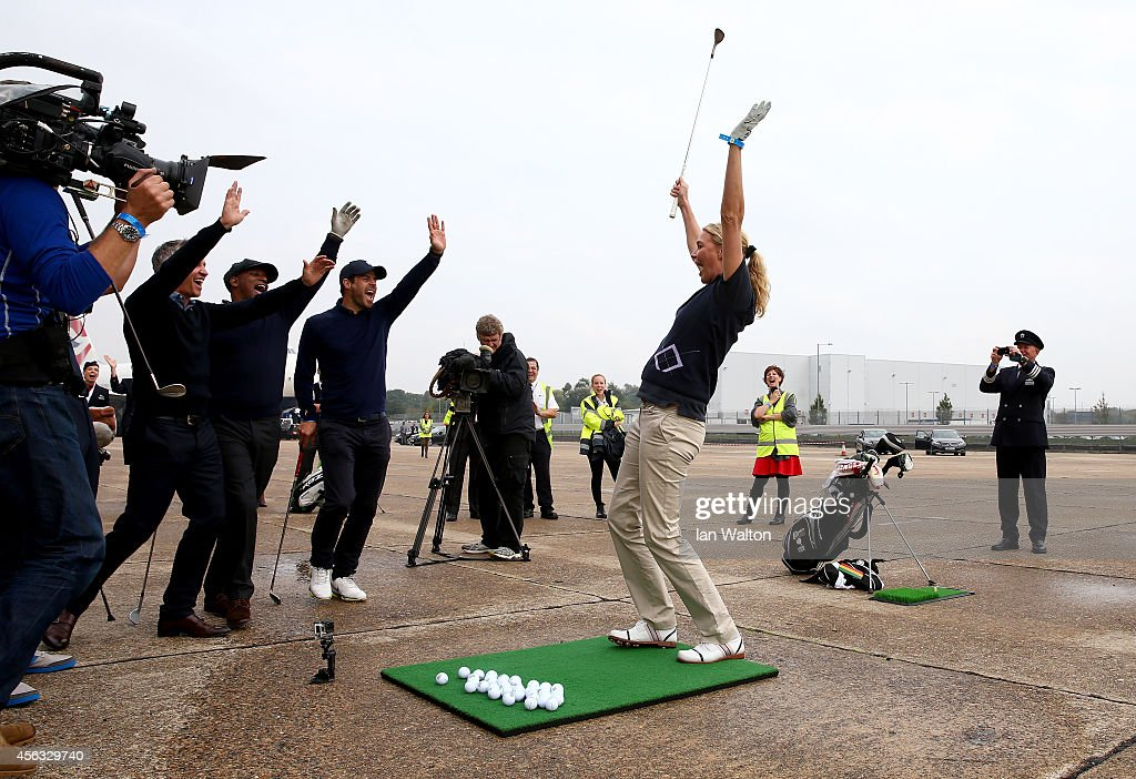 <a gi-track='captionPersonalityLinkClicked' href=/galleries/search?phrase=Jodie+Kidd&family=editorial&specificpeople=178960 ng-click='$event.stopPropagation()'>Jodie Kidd</a> reacts after playing a shot to a target 180 yards away during an event to raise funds for the Kate and Justin Rose Foundation at Heathrow Airport on September 29, 2014 in London, England. British Airways has donated flights to the Kate and Justin Rose foundation, which was created to inspire children through nutrition, education and experiences