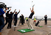 Jodie Kidd reacts after playing a shot to a target 180 yards away during an event to raise funds for the Kate and Justin Rose Foundation at Heathrow...