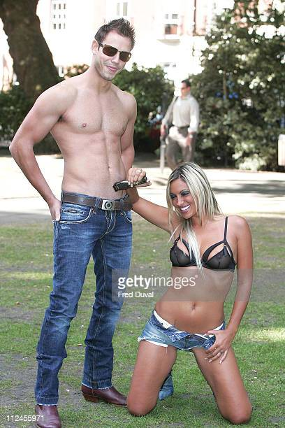 Jodie Marsh and Model during Jodie Marsh Promotes the Remington High Precision Body Hair Trimmer August 8 2005 at Soho Square in London Great Britain