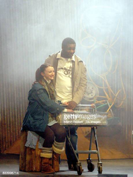 Jodie McNee and Kenny Thompson star as Mary and Joseph as their baby Jesus is sleeps in a shopping trolley during the Liverpool Nativity a modern...