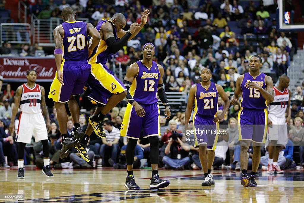 Jodie Meeks and Kobe Bryant of the Los Angeles Lakers celebrate during the closing minutes of the Lakers 10296 win over the Washington Wizards at...