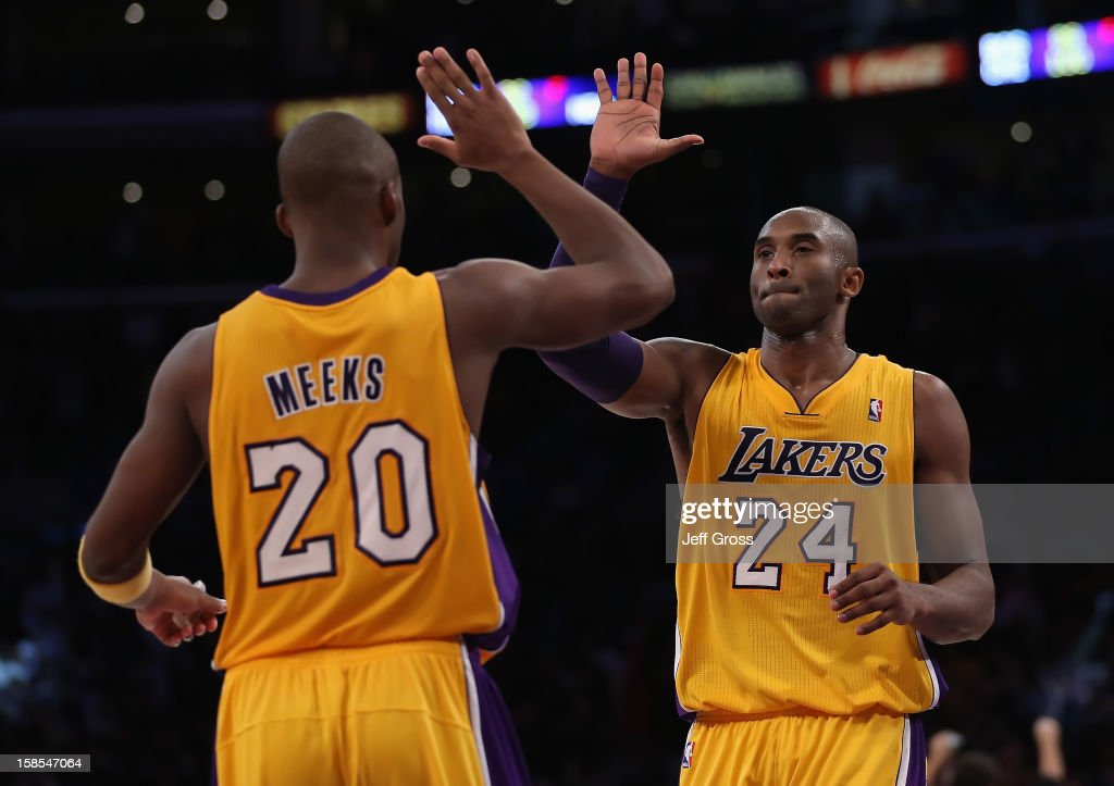 Jodie Meeks #20 and Kobe Bryant #24 of the Los Angeles Lakers celebrate their teams 101-100 victory over the Charlotte Bobcats at Staples Center on December 18, 2012 in Los Angeles, California.
