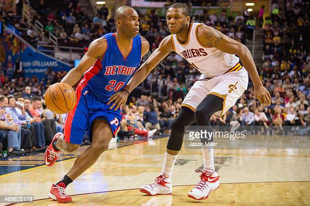 Jodie Meeks of the Detroit Pistons drives around James Jones of the Cleveland Cavaliers during the first half at Quicken Loans Arena on April 13 2014...