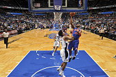 Jodie Meeks of the Detroit Pistons goes to the basket against Elfrid Payton of the Orlando Magic on December 30 2014 at Amway Center in Orlando...