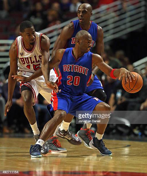 Jodie Meeks of the Detroit Pistons moves around Jordan Crawford of the Chicago Bulls during a preseason game at the United Center on October 14 2015...