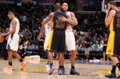 Jodie Meeks of the Los Angeles Lakers and Gerald Henderson of the Charlotte Bobcats hug after a game at STAPLES Center on January 31 2014 in Los...