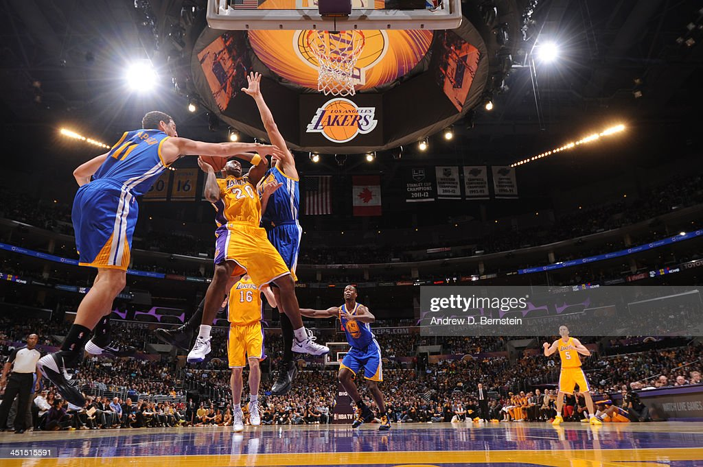 <a gi-track='captionPersonalityLinkClicked' href=/galleries/search?phrase=Jodie+Meeks&family=editorial&specificpeople=4001727 ng-click='$event.stopPropagation()'>Jodie Meeks</a> #20 of the Los Angeles Lakers attempts a shot against <a gi-track='captionPersonalityLinkClicked' href=/galleries/search?phrase=Andrew+Bogut&family=editorial&specificpeople=207105 ng-click='$event.stopPropagation()'>Andrew Bogut</a> #12 of the Golden State Warriors on November 22, 2013 at STAPLES Center in Los Angeles, California.