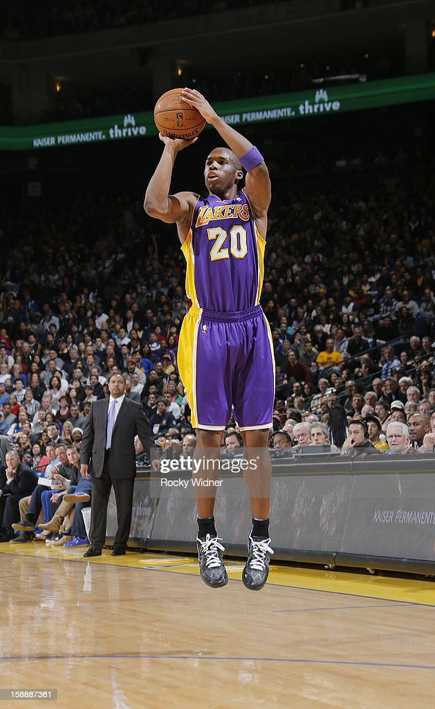 <a gi-track='captionPersonalityLinkClicked' href=/galleries/search?phrase=Jodie+Meeks&family=editorial&specificpeople=4001727 ng-click='$event.stopPropagation()'>Jodie Meeks</a> #20 of the Los Angeles Lakers attempts a three pointer against the Golden State Warriors on December 22, 2012 at Oracle Arena in Oakland, California.