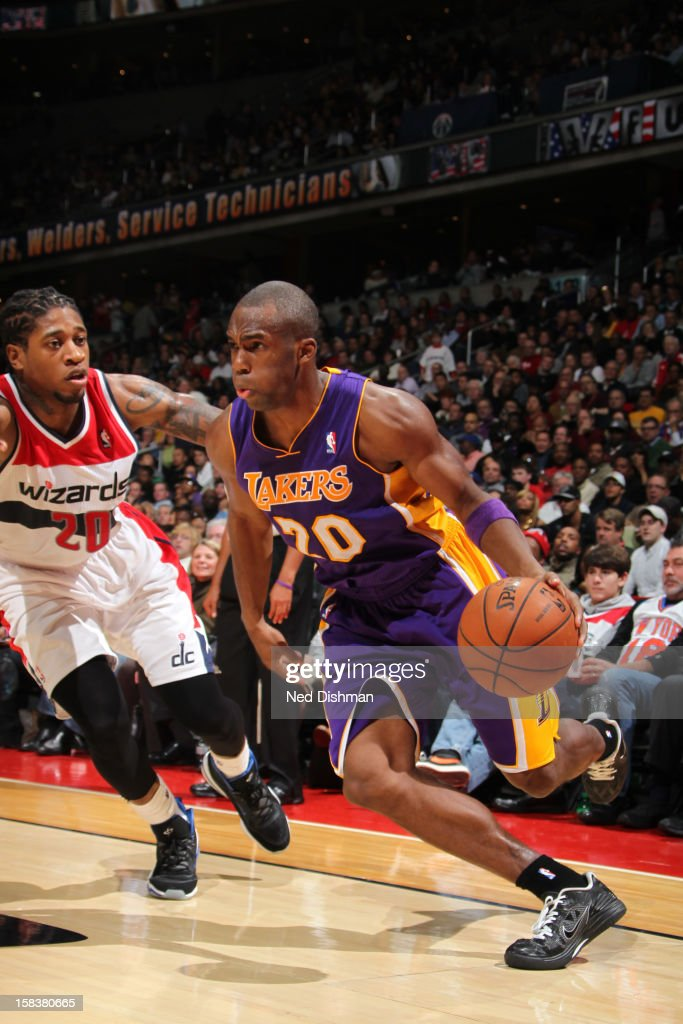Jodie Meeks #20 of the Los Angeles Lakers drives against Cartier Martin #20 of the Washington Wizards during the game at the Verizon Center on December 14, 2012 in Washington, DC.