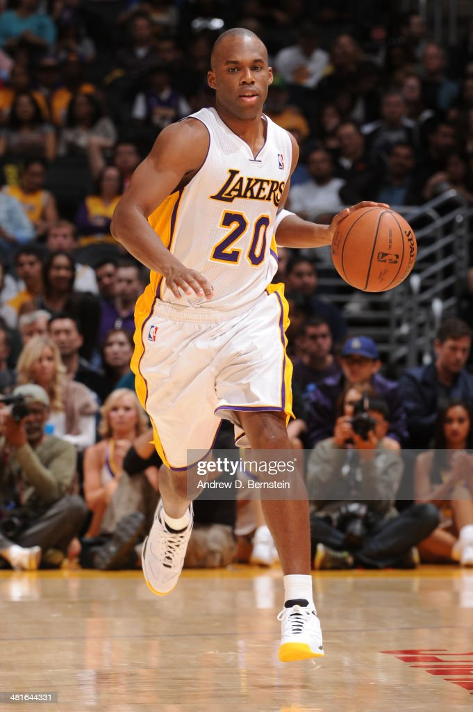 <a gi-track='captionPersonalityLinkClicked' href=/galleries/search?phrase=Jodie+Meeks&family=editorial&specificpeople=4001727 ng-click='$event.stopPropagation()'>Jodie Meeks</a> #20 of the Los Angeles Lakers drives against the Phoenix Suns at STAPLES Center on March 30, 2014 in Los Angeles, California.