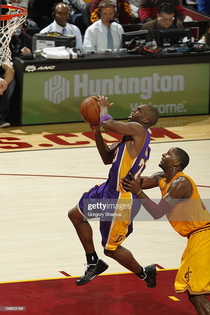 <a gi-track='captionPersonalityLinkClicked' href=/galleries/search?phrase=Jodie+Meeks&family=editorial&specificpeople=4001727 ng-click='$event.stopPropagation()'>Jodie Meeks</a> #20 of the Los Angeles Lakers drives to the basket against the Cleveland Cavaliers at The Quicken Loans Arena on December 11, 2012 in Cleveland, Ohio.