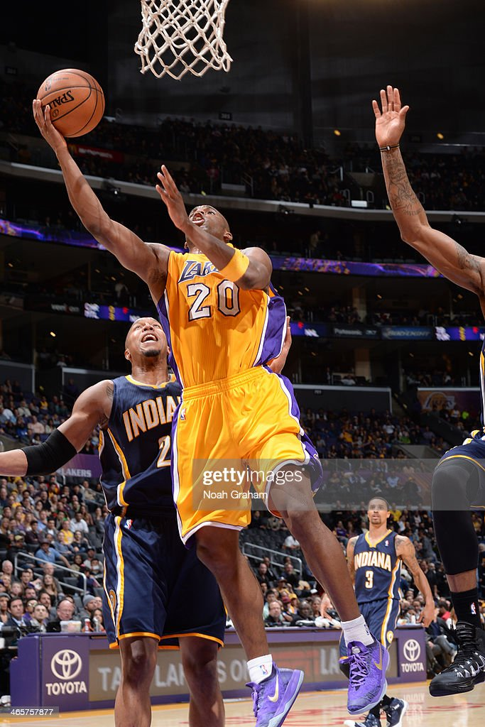 Jodie Meeks of the Los Angeles Lakers drives to the basket against the Indiana Pacers at STAPLES Center on January 28 2014 in Los Angeles California...
