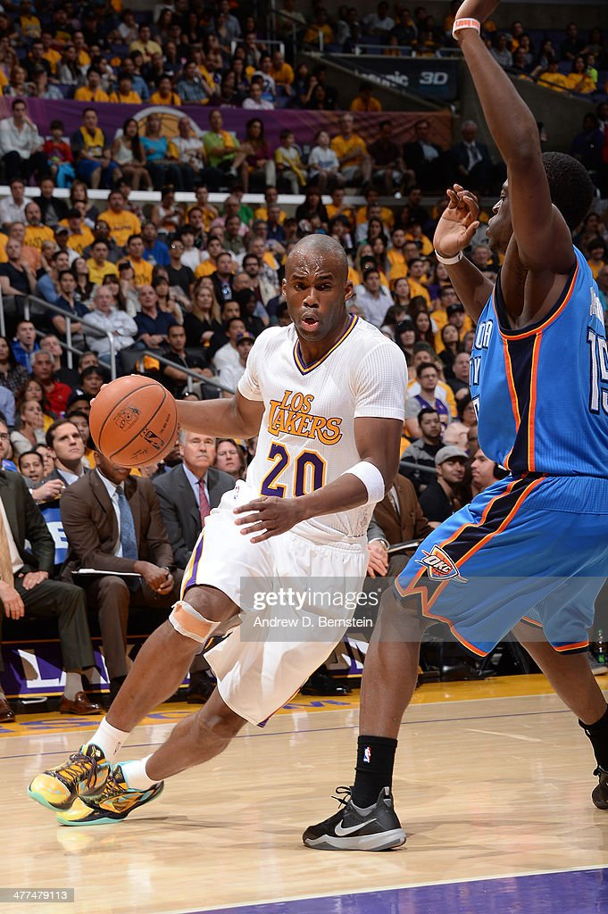 <a gi-track='captionPersonalityLinkClicked' href=/galleries/search?phrase=Jodie+Meeks&family=editorial&specificpeople=4001727 ng-click='$event.stopPropagation()'>Jodie Meeks</a> #20 of the Los Angeles Lakers drives to the basket against the Oklahoma City Thunder at STAPLES Center on March 9, 2014 in Los Angeles, California.