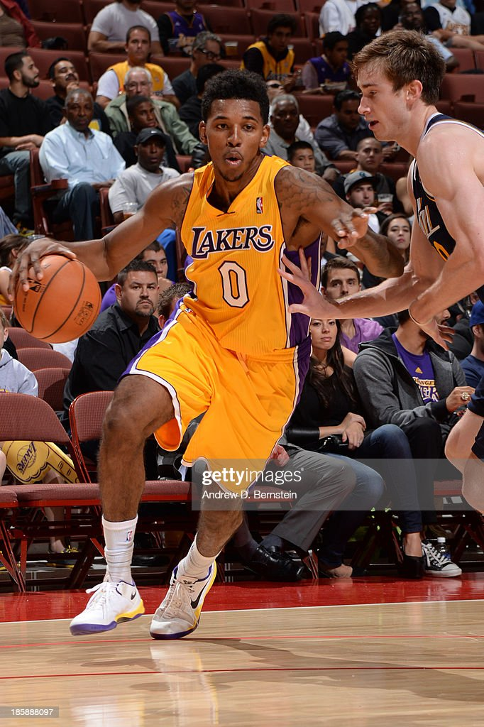 <a gi-track='captionPersonalityLinkClicked' href=/galleries/search?phrase=Jodie+Meeks&family=editorial&specificpeople=4001727 ng-click='$event.stopPropagation()'>Jodie Meeks</a> #20 of the Los Angeles Lakers drives to the basket during a preseason game against the Utah Jazz at the Honda Center in Anaheim, California on October 25, 2013.