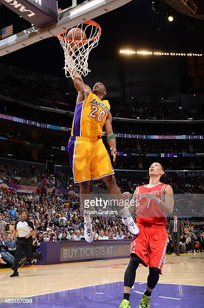 Jodie Meeks of the Los Angeles Lakers dunks against Jeremy Lin of the Houston Rockets at Staples Center on April 8 2014 in Los Angeles California...