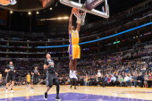 Jodie Meeks of the Los Angeles Lakers dunks against the Minnesota Timberwolves at Staples Center on December 20 2013 in Los Angeles California NOTE...