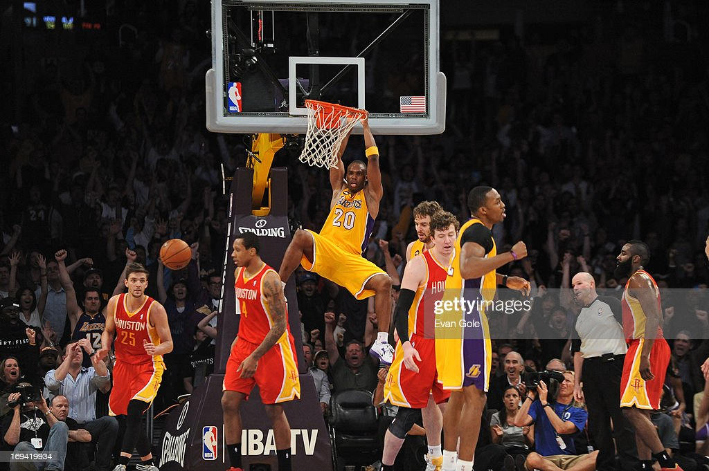 <a gi-track='captionPersonalityLinkClicked' href=/galleries/search?phrase=Jodie+Meeks&family=editorial&specificpeople=4001727 ng-click='$event.stopPropagation()'>Jodie Meeks</a> #20 of the Los Angeles Lakers dunks the ball against the Houston Rockets at Staples Center on April 17, 2013 in Los Angeles, California.