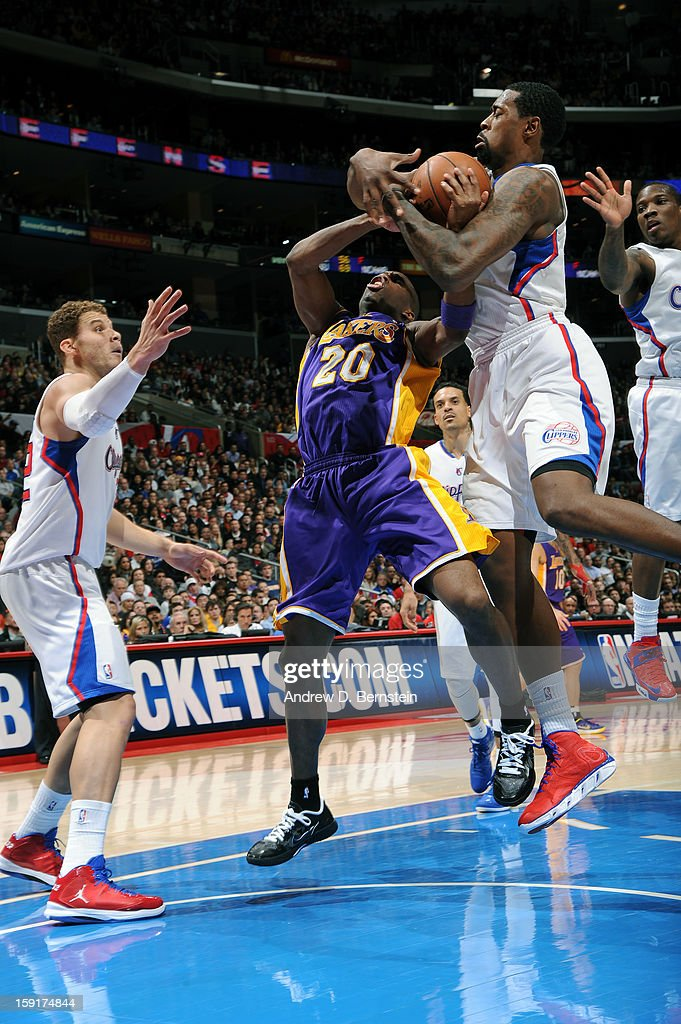 Jodie Meeks #20 of the Los Angeles Lakers fights for control of the ball against the Los Angeles Clippers at Staples Center on January 4, 2013 in Los Angeles, California.