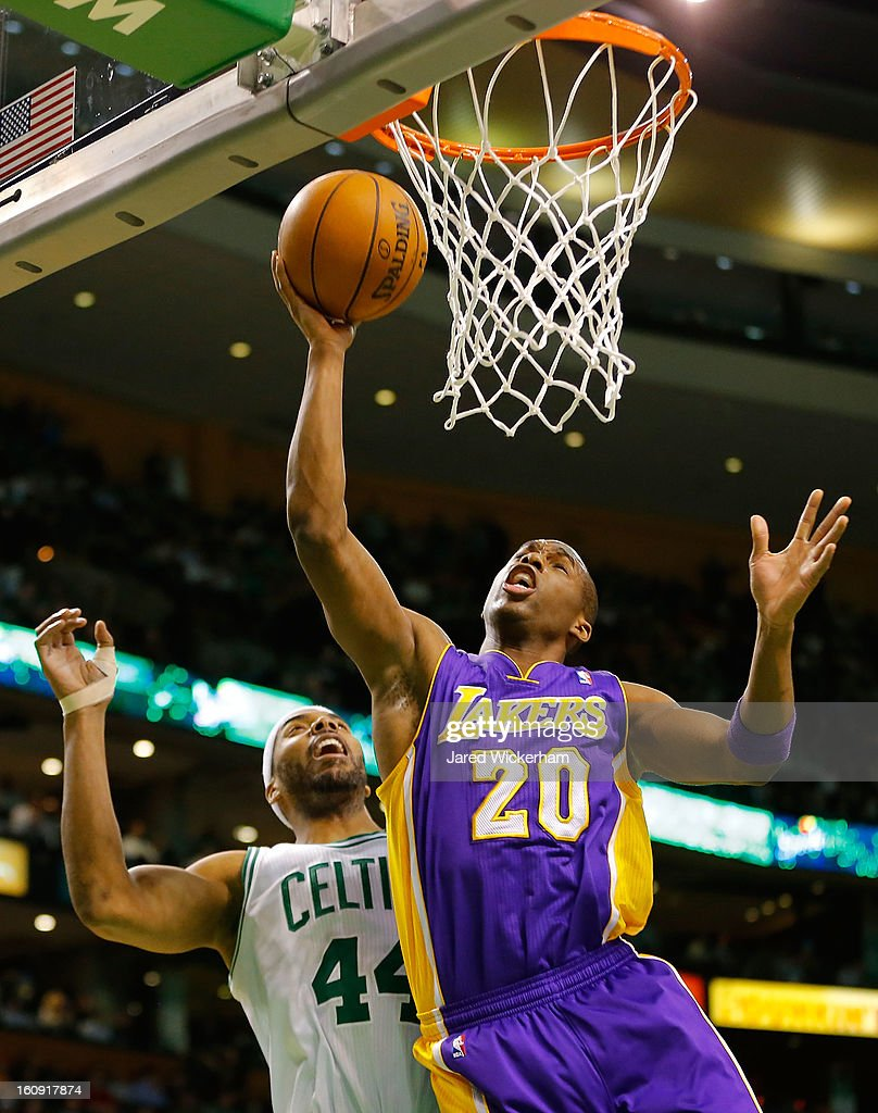 Jodie Meeks #20 of the Los Angeles Lakers goes up for a layup in front of Chris Wilcox #44 of the Boston Celtics during the game on February 7, 2013 at TD Garden in Boston, Massachusetts.