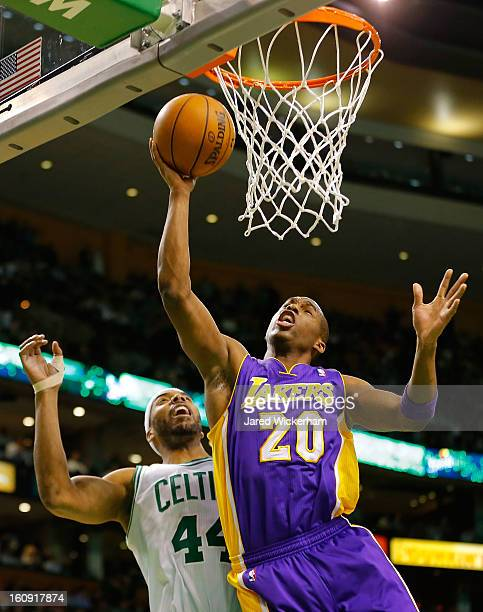 Jodie Meeks of the Los Angeles Lakers goes up for a layup in front of Chris Wilcox of the Boston Celtics during the game on February 7 2013 at TD...