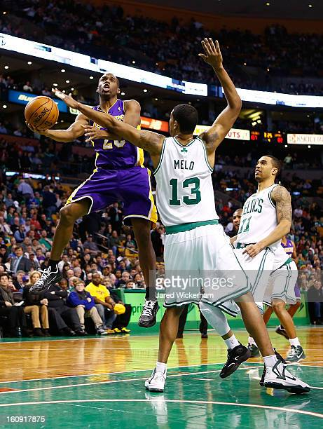 Jodie Meeks of the Los Angeles Lakers goes up for a layup over Fab Melo of the Boston Celtics during the game on February 7 2013 at TD Garden in...