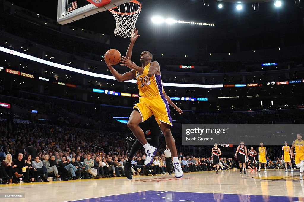 <a gi-track='captionPersonalityLinkClicked' href=/galleries/search?phrase=Jodie+Meeks&family=editorial&specificpeople=4001727 ng-click='$event.stopPropagation()'>Jodie Meeks</a> #20 of the Los Angeles Lakers goes up for a shot against the Portland Trail Blazers at Staples Center on December 28, 2012 in Los Angeles, California.