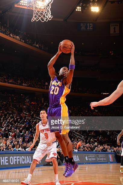Jodie Meeks of the Los Angeles Lakers grabs a rebound against the New York Knicks at Madison Square Garden on January 26 2014 in New York New York...