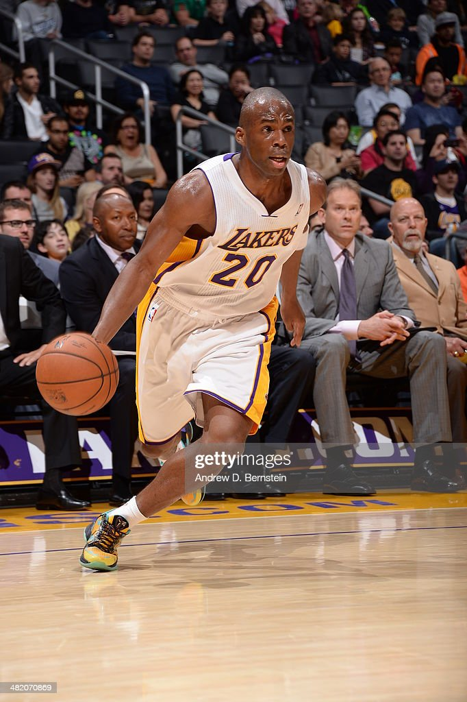 <a gi-track='captionPersonalityLinkClicked' href=/galleries/search?phrase=Jodie+Meeks&family=editorial&specificpeople=4001727 ng-click='$event.stopPropagation()'>Jodie Meeks</a> #20 of the Los Angeles Lakers handles the ball against the Orlando Magic at Staples Center on March 23, 2014 in Los Angeles, California.