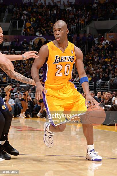Jodie Meeks of the Los Angeles Lakers handles the basketball during a game against the Utah Jazz at STAPLES Center on January 3 2013 in Los Angeles...