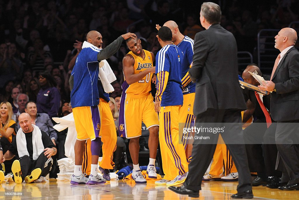 Jodie Meeks #20 of the Los Angeles Lakers is congratulated by teammate Kobe Bryant #24 during their game against the Utah Jazz at Staples Center on January 25, 2013 in Los Angeles, California.