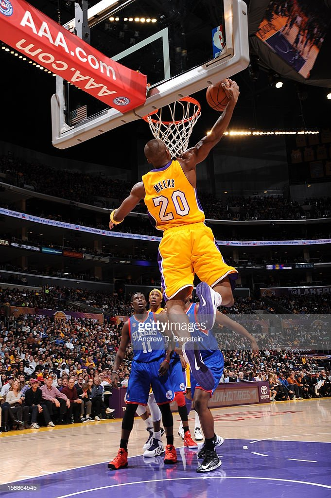 Jodie Meeks #20 of the Los Angeles Lakers rises for a reverse dunk against the Philadelphia 76ers at Staples Center on January 1, 2013 in Los Angeles, California.