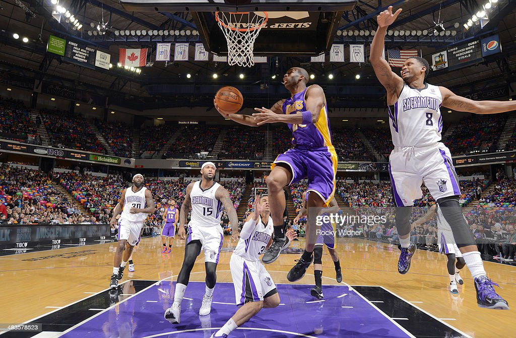 <a gi-track='captionPersonalityLinkClicked' href=/galleries/search?phrase=Jodie+Meeks&family=editorial&specificpeople=4001727 ng-click='$event.stopPropagation()'>Jodie Meeks</a> #20 of the Los Angeles Lakers shoots a layup against <a gi-track='captionPersonalityLinkClicked' href=/galleries/search?phrase=Rudy+Gay&family=editorial&specificpeople=236066 ng-click='$event.stopPropagation()'>Rudy Gay</a> #8 of the Sacramento Kings on April 2, 2014 at Sleep Train Arena in Sacramento, California.