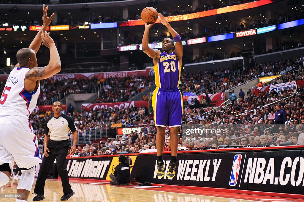 Jodie Meeks #20 of the Los Angeles Lakers shoots a three-pointer against the Los Angeles Clippers at Staples Center on January 4, 2013 in Los Angeles, California.