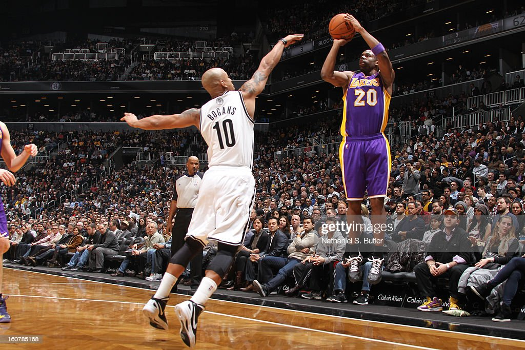 Jodie Meeks #20 of the Los Angeles Lakers shoots against Keith Bogans #10 of the Brooklyn Nets on February 5, 2013 at the Barclays Center in the Brooklyn borough of New York City.