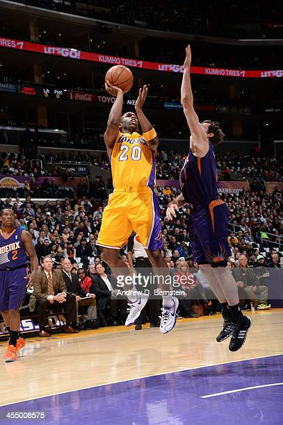 Jodie Meeks of the Los Angeles Lakers shoots against the Phoenix Suns at Staples Center on December 10 2013 in Los Angeles California NOTE TO USER...