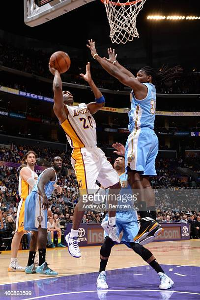 Jodie Meeks of the Los Angeles Lakers shoots during a game against the Denver Nuggets at STAPLES Center on January 5 2014 in Los Angeles California...