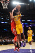 Jodie Meeks of the Los Angeles Lakers shoots during a game against the Houston Rockets at STAPLES Center on February 19 2014 in Los Angeles...