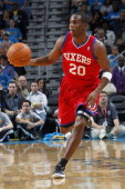 Jodie Meeks of the Philadelphia 76ers brings the ball up court during an NBA game between the Philadelphia 76ers and the New Orleans Hornets on...