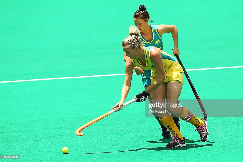 Jodie Schulz of the Hockeyroos is challenged by Mariah Williams of the Jillaroos in the Hockeyroos v Jillaroos finals match during day four of the 2012 International Super Series at Perth Hockey Stadium on November 25, 2012 in Perth, Australia.