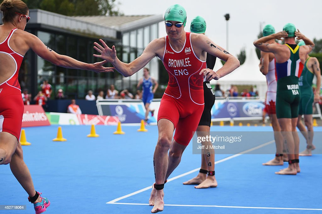 Jodie Stimpson of England hands over to Alistair Brownlee of England in the Triathlon Mixed Team's Relay Final at Strathclyde Country Park during day...
