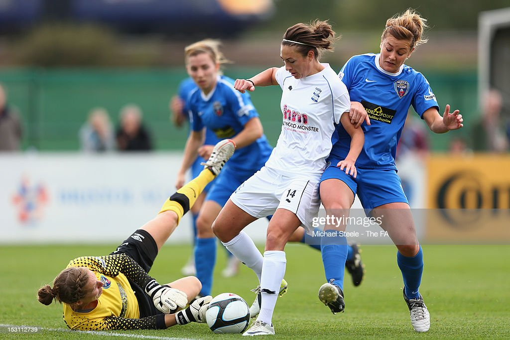 Jodie Taylor of Birmingham City Ladies FC goes round goalkeeper Siobhan Chamberlain and Jemma Rose of Bristol Academy Women's FC during the FA WSL...